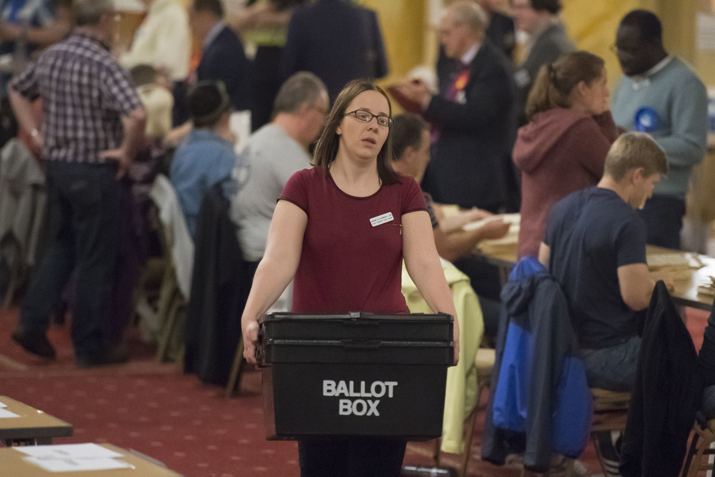 CARDIFF, UNITED KINGDOM - JUNE 08: A woman carries boxes of ballot papers at City Hall on June 8, 2017 in Cardiff, United Kingdom. After a snap election was called, the United Kingdom went to the polls yesterday following a closely fought election. The results from across the country are being counted and an overall result is expected in the early hours. (Photo by Matthew Horwood/Getty Images)