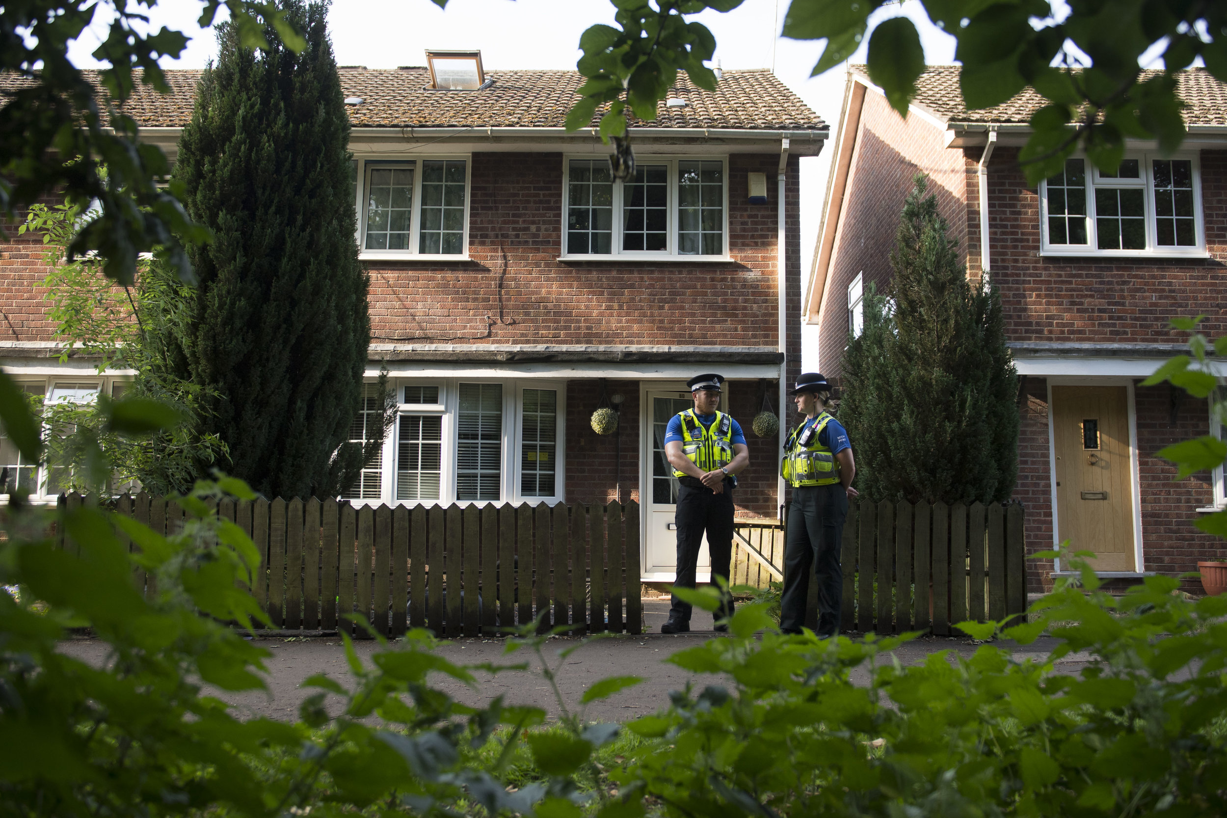 CARDIFF, WALES - JUNE 19: Two PCSOs stand outside a property during a search of a house on Glyn Rhosyn, Pentwyn, which is believed to be the home of Darren Osborne, who has been named as the man responsible for the Finsbury Park Mosque attack, on June 19, 2017 in Cardiff, Wales. A van ploughed into pedestrians near Finsbury Park Mosque on Severn Sisters Road, North London, at around 12.20 this morning. Police have reported that eight people were injured and one killed. A 48-year-old man has been arrested. Prime Minister Theresa May has said police are treating it as a potential terrorist incident. (Photo by Matthew Horwood/Getty Images)