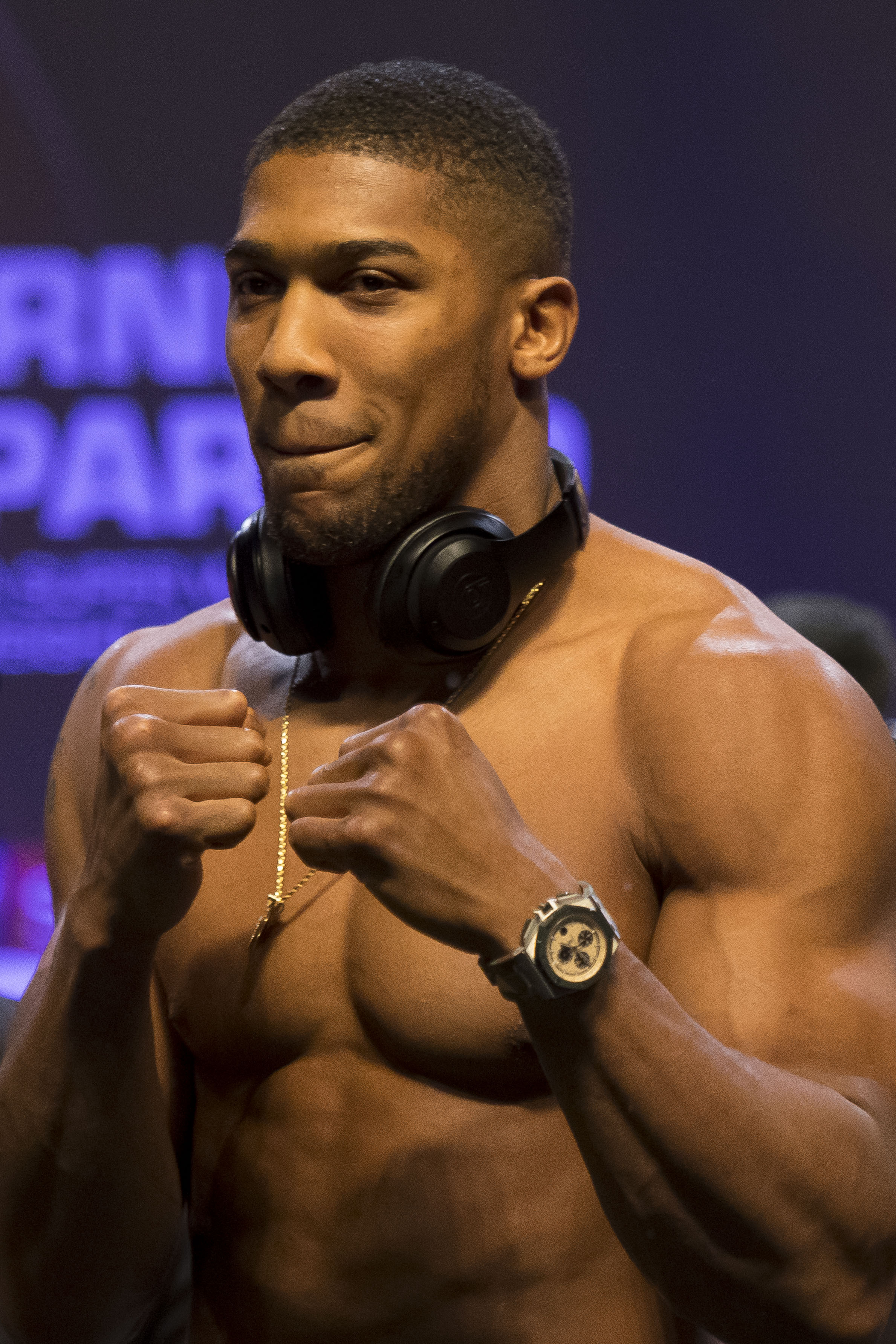 CARDIFF, WALES - MARCH 30: Anthony Joshua poses for the cameras during the weigh-in at the Motorpoint Arena on March 30, 2018 in Cardiff, Wales. Anthony Joshua will fight Joseph Parker in a heavyweight unification match at the Principality Stadium in Cardiff on March 31. (Photo by Matthew Horwood/Getty Images)