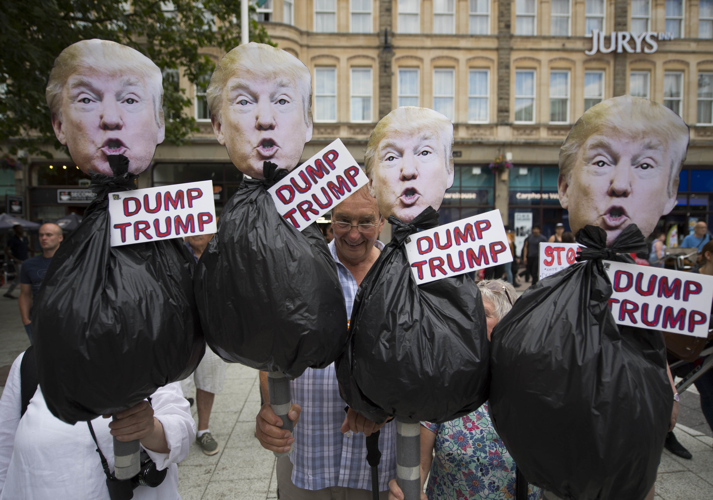 CARDIFF, UNITED KINGDOM - JULY 12: Protestors hold anti Donald Trump signs during a protest on Queen Street against a visit by the President of the United States Donald Trump on July 12, 2018 in Cardiff, United Kingdom. The President of the United States and First Lady, Melania Trump, have arrived in the United Kingdom for their first official visit. They are due to have dinner at Blenheim Palace, visit Prime Minister Theresa May at Chequers and have tea with the Queen at Windsor Castle. (Photo by Matthew Horwood/Getty Images)