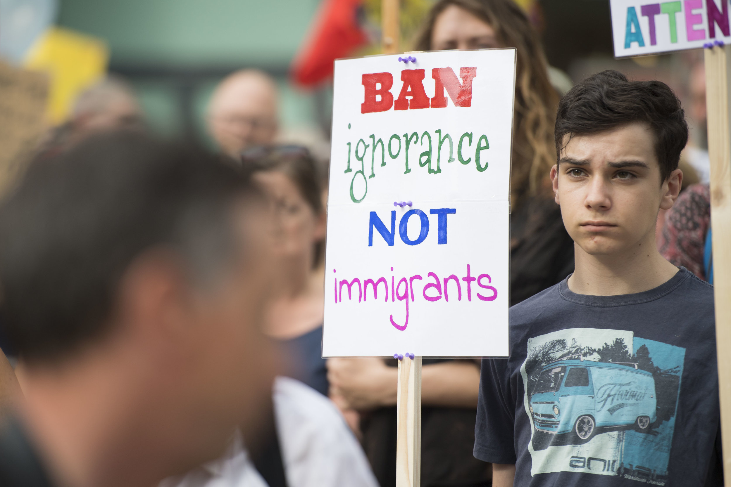 CARDIFF, UNITED KINGDOM - JULY 12: Anti Donald Trump signs are seen as protestors gather outside Cardiff Library on the Hayes in Cardiff to protest against a visit by the President of the United States Donald Trump on July 12, 2018 in Cardiff, United Kingdom. The President of the United States and First Lady, Melania Trump, have arrived in the United Kingdom for their first official visit. They are due to have dinner at Blenheim Palace, visit Prime Minister Theresa May at Chequers and have tea with the Queen at Windsor Castle. (Photo by Matthew Horwood/Getty Images)