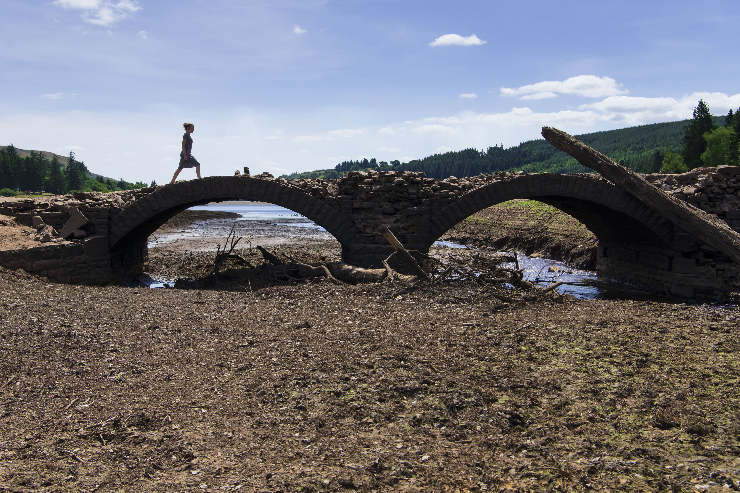 MERTHYR TYDFIL, WALES - JULY 25: A girl crosses a bridge at the Llwyn-on Reservoir, owned by Welsh Water, in the Taf Fawr valley on July 25, 2018 in Merthyr Tydfil, Wales. The lack of rainfall over the last few weeks combined with record breaking temperatures is having a dramatic effect on water levels in reservoirs. (Photo by Matthew Horwood/Getty Images)