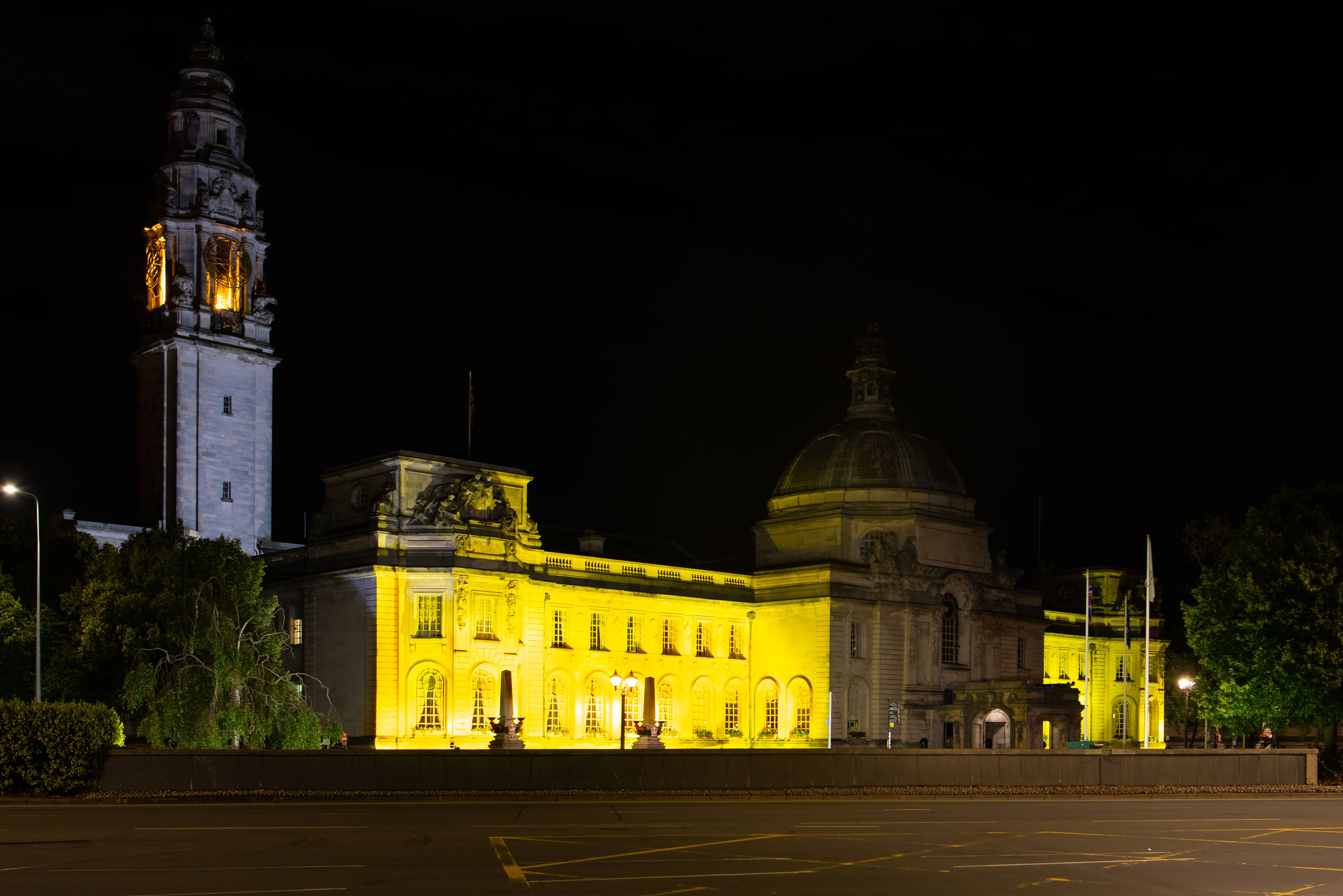 CARDIFF, WALES - JULY 29: Cardiff City Hall is seen illuminated in yellow light following cyclist Geraint Thomas' victory in the Tour De France on July 29, 2018 in Cardiff, Wales. Team Sky's Geraint Thomas, who was born in Cardiff, is the first Welshman to have won the Tour de France. The yellow illumination represents the colour of the yellow jersey worn by the race leader.