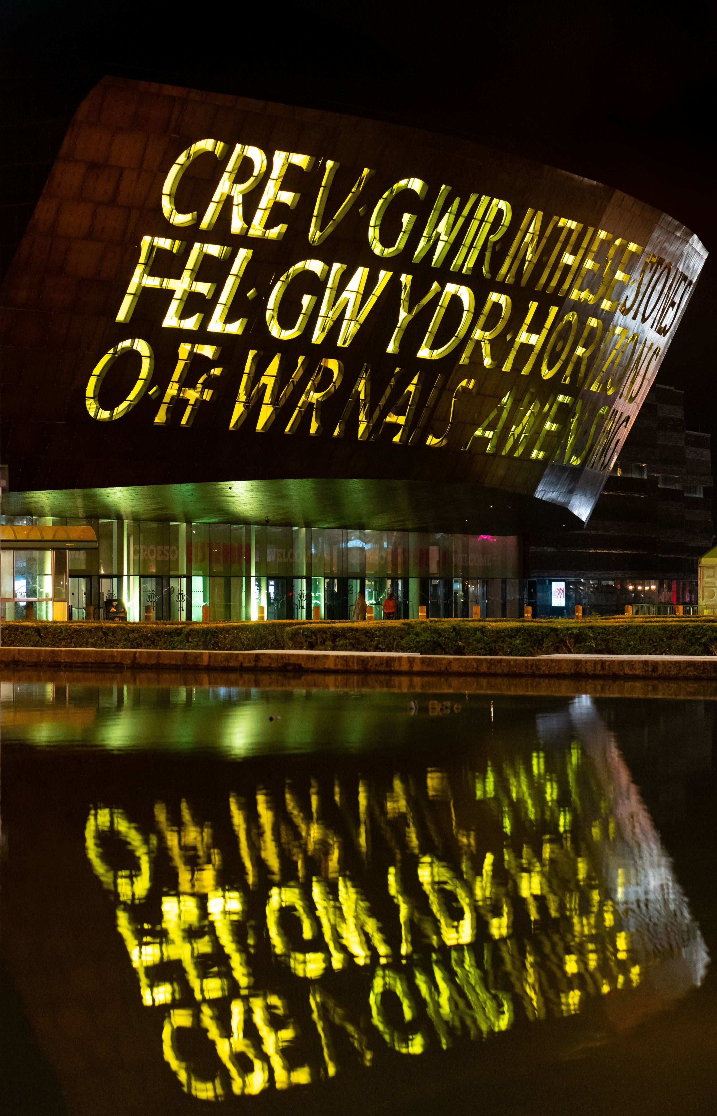 CARDIFF, WALES - JULY 29: The Wales Millennium Centre, Wales' national centre for performing arts, is seen illuminated in yellow light following cyclist Geraint Thomas' victory in the Tour De France on July 29, 2018 in Cardiff, Wales. Team Sky's Geraint Thomas, who was born in Cardiff, is the first Welshman to have won the Tour de France. The yellow illumination represents the colour of the yellow jersey worn by the race leader.