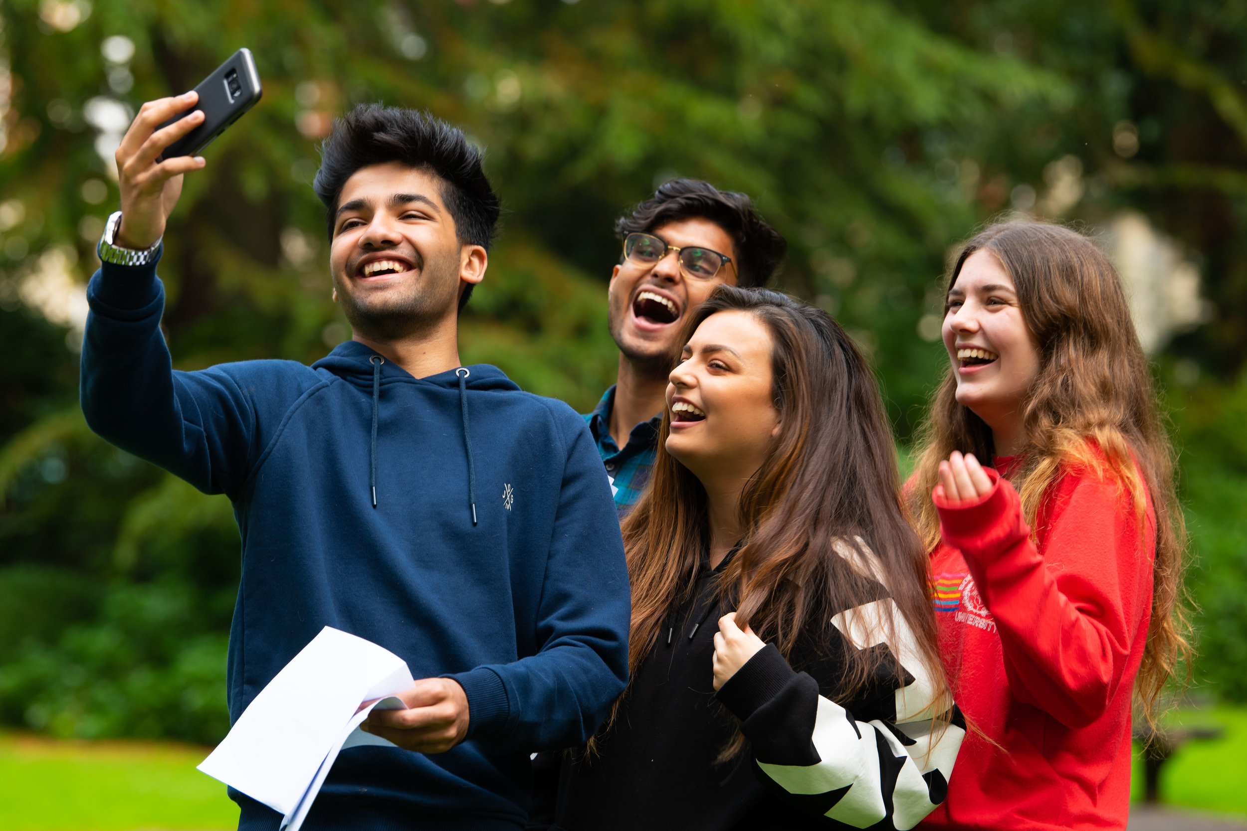 SWANSEA, UNITED KINGDOM - AUGUST 16: Adan Khan (L) takes a selfie with Abu Jaffar Latif, Victoria Baker and Angharad Howden-Evans on A Level results day at Ffynone House School on August 16, 2018 in Swansea, United Kingdom. A level examination has been changed in the past year as coursework has been ditched for an exam only based results system. (Photo by Matthew Horwood/Getty Images)
