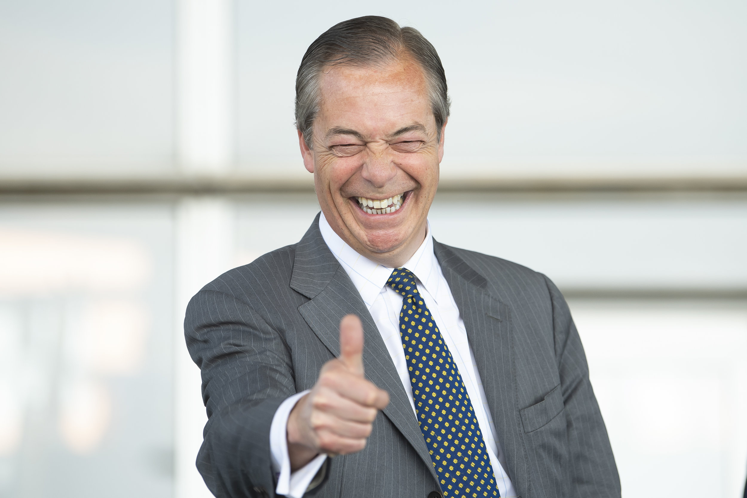 CARDIFF, WALES - MAY 15: Leader of the Brexit Party Nigel Farage gives a thumbs up sign at the Senedd in Cardiff Bay on May 15, 2019 in Cardiff, Wales. Nigel Farage, leader of the Brexit Party and former leader of the U.K. Independence Party, is campaigning for the Brexit Party ahead of this month's European Parliament elections. Despite voting to leave the European Union in 2016, Britain is braced to take part in the European Parliament elections on May 23. (Photo by Matthew Horwood/Getty Images)