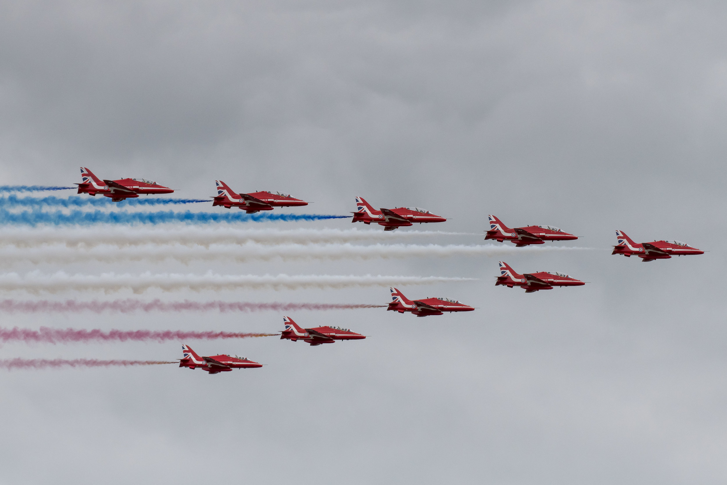 FAIRFORD, ENGLAND - JULY 21: The Red Arrows (BAE Hawk) perform during the International Air Tattoo at RAF Fairford on July 21, 2019 in Fairford, England. The Royal International Air Tattoo (RIAT) is the world's largest military air show, held in support of The Royal Air Force Charitable Trust. (Photo by Matthew Horwood/Getty Images)