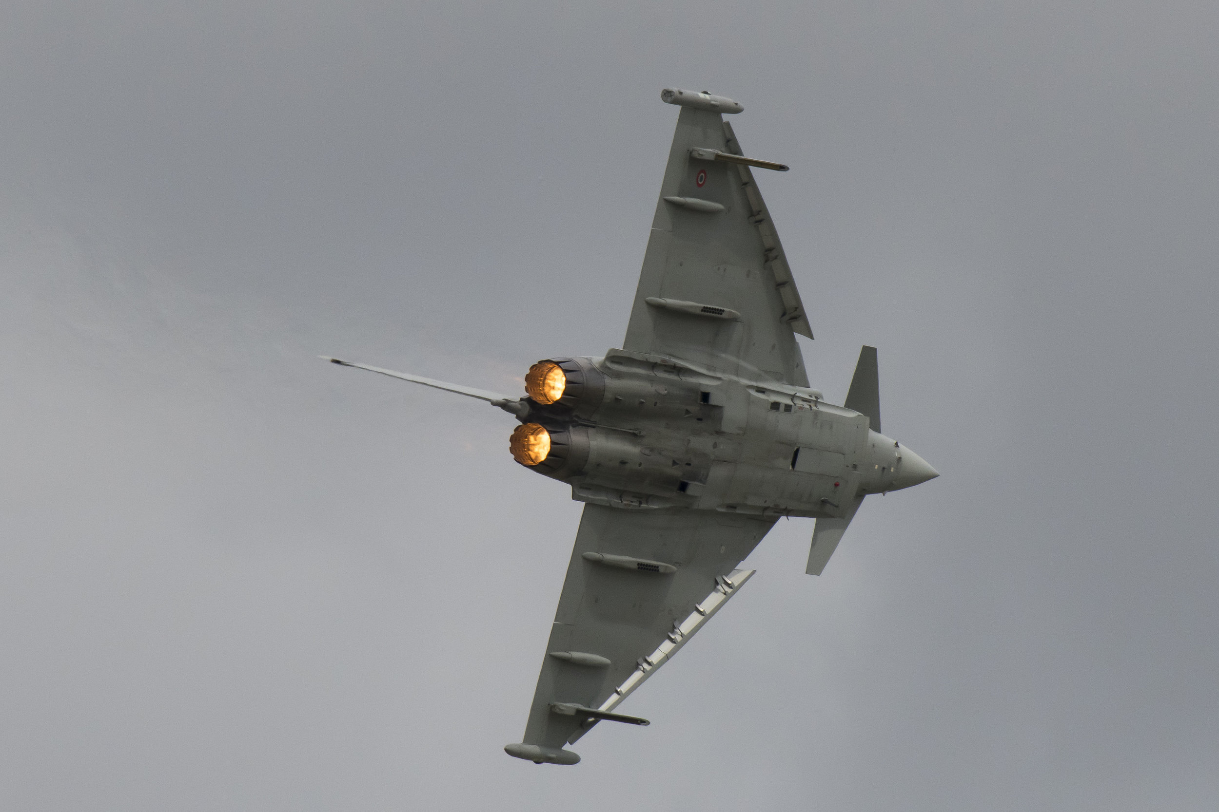 FAIRFORD, ENGLAND - JULY 21: An Italian Air Force F-2000 Typhoon performs during the International Air Tattoo at RAF Fairford on July 21, 2019 in Fairford, England. The Royal International Air Tattoo (RIAT) is the world's largest military air show, held in support of The Royal Air Force Charitable Trust. (Photo by Matthew Horwood/Getty Images)