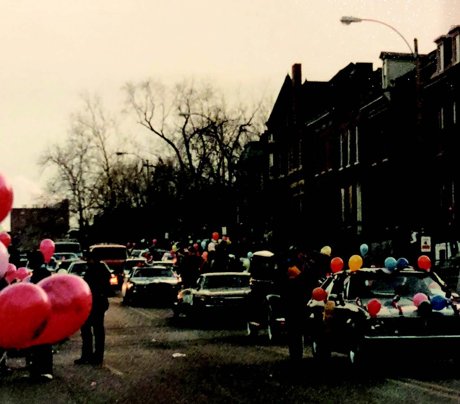 Circa 1985 mardi gras parade traveling northbound on 12th street at sunset.