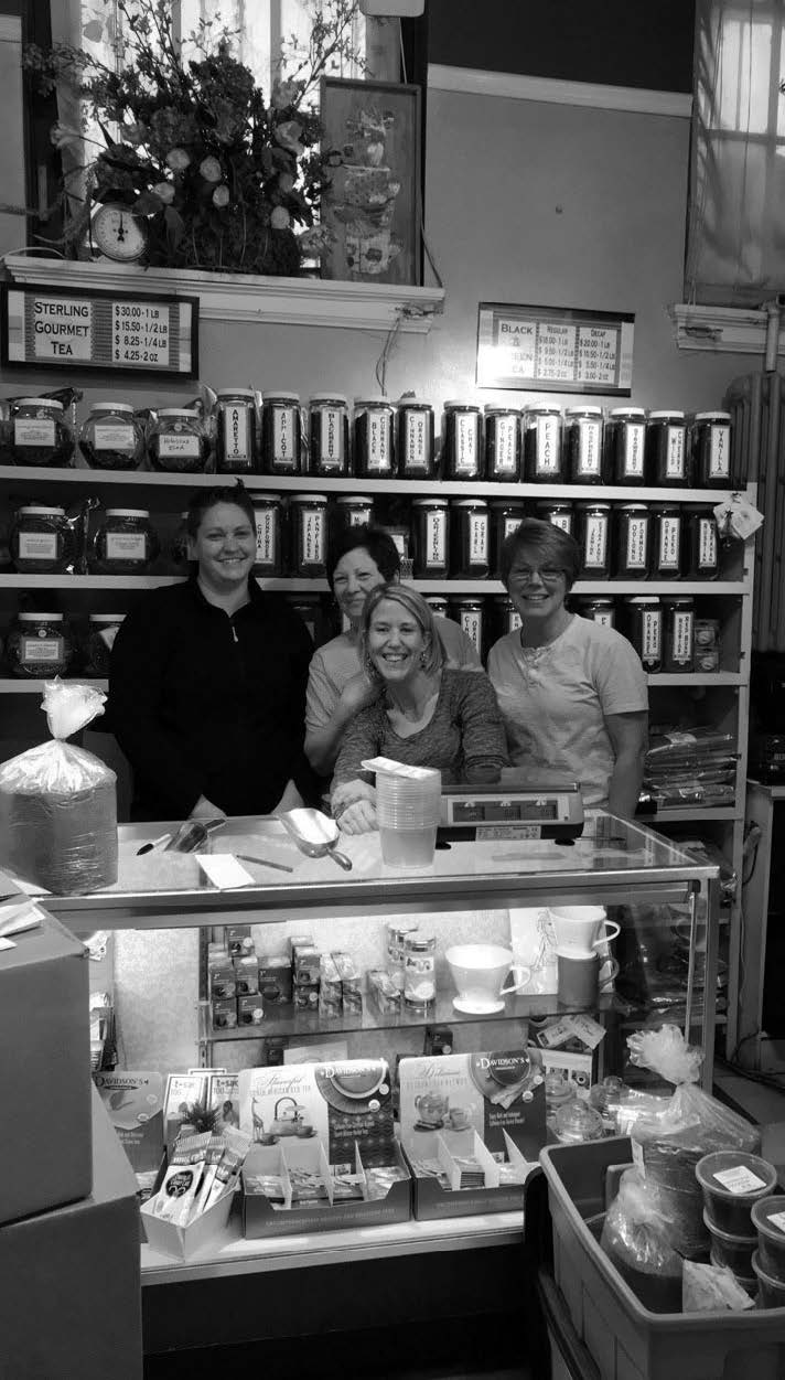 The staff is on duty at the Soulard Spice Shop.