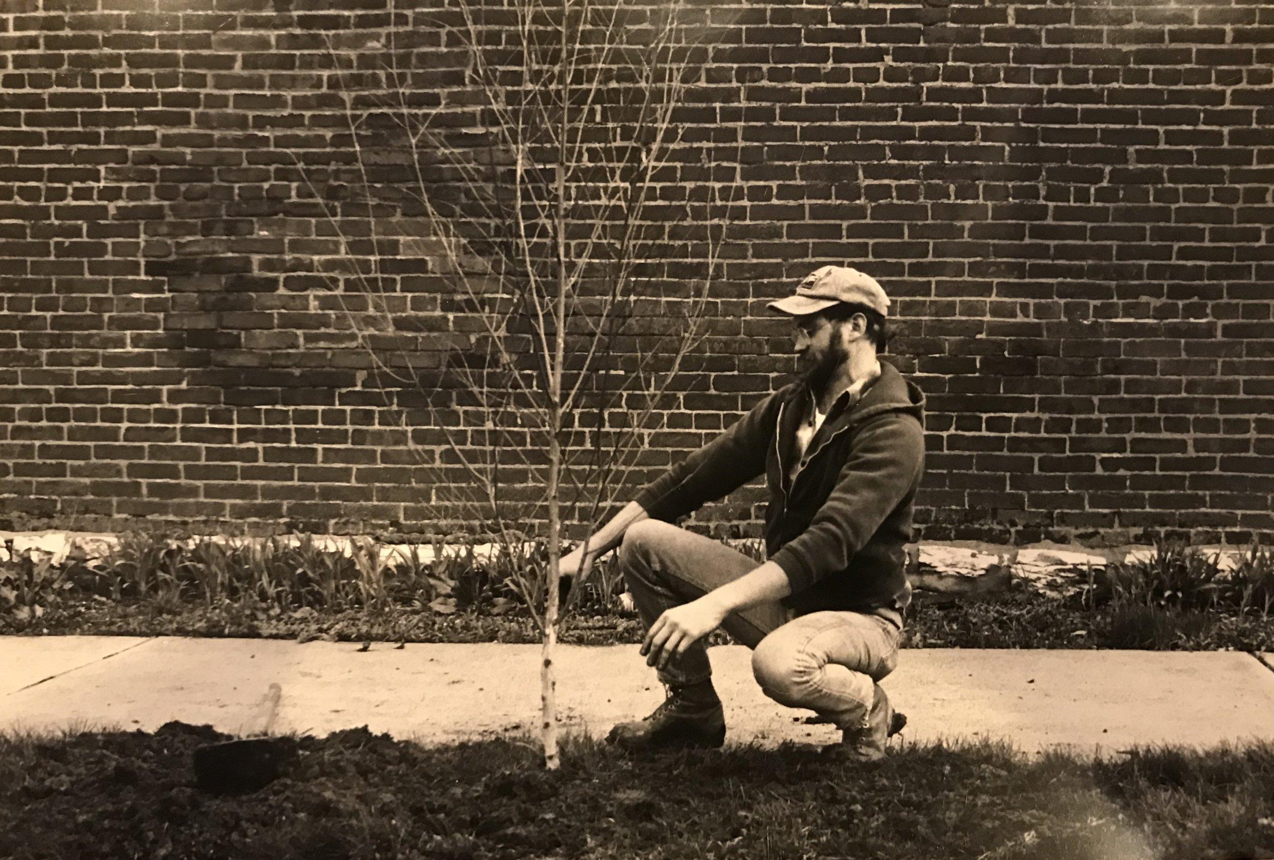 "Longtime resident John Durnell plants a tree as part of the ""I Leaf Soulard"" program"