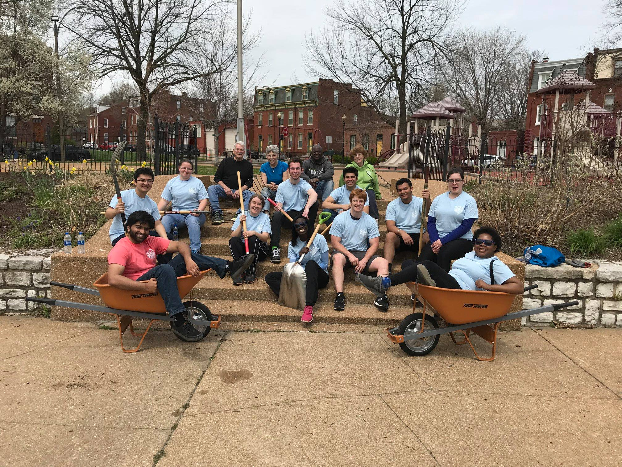School and corporate groups often lend a hand beautifying Pontiac Park at the guidance of Beautification Chair Richard Eaton, back left