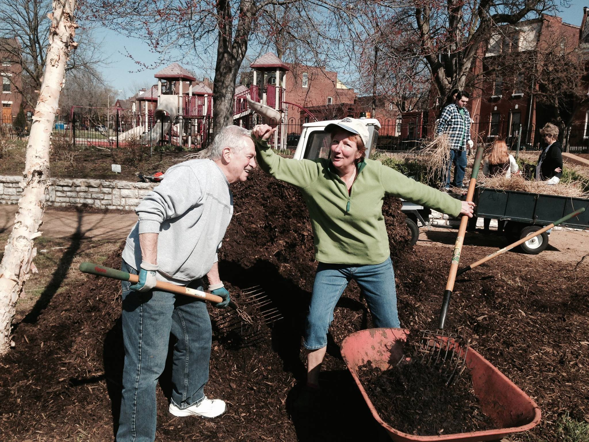 Beautification Committee members have fun while adding new mulch to Pontiac Park