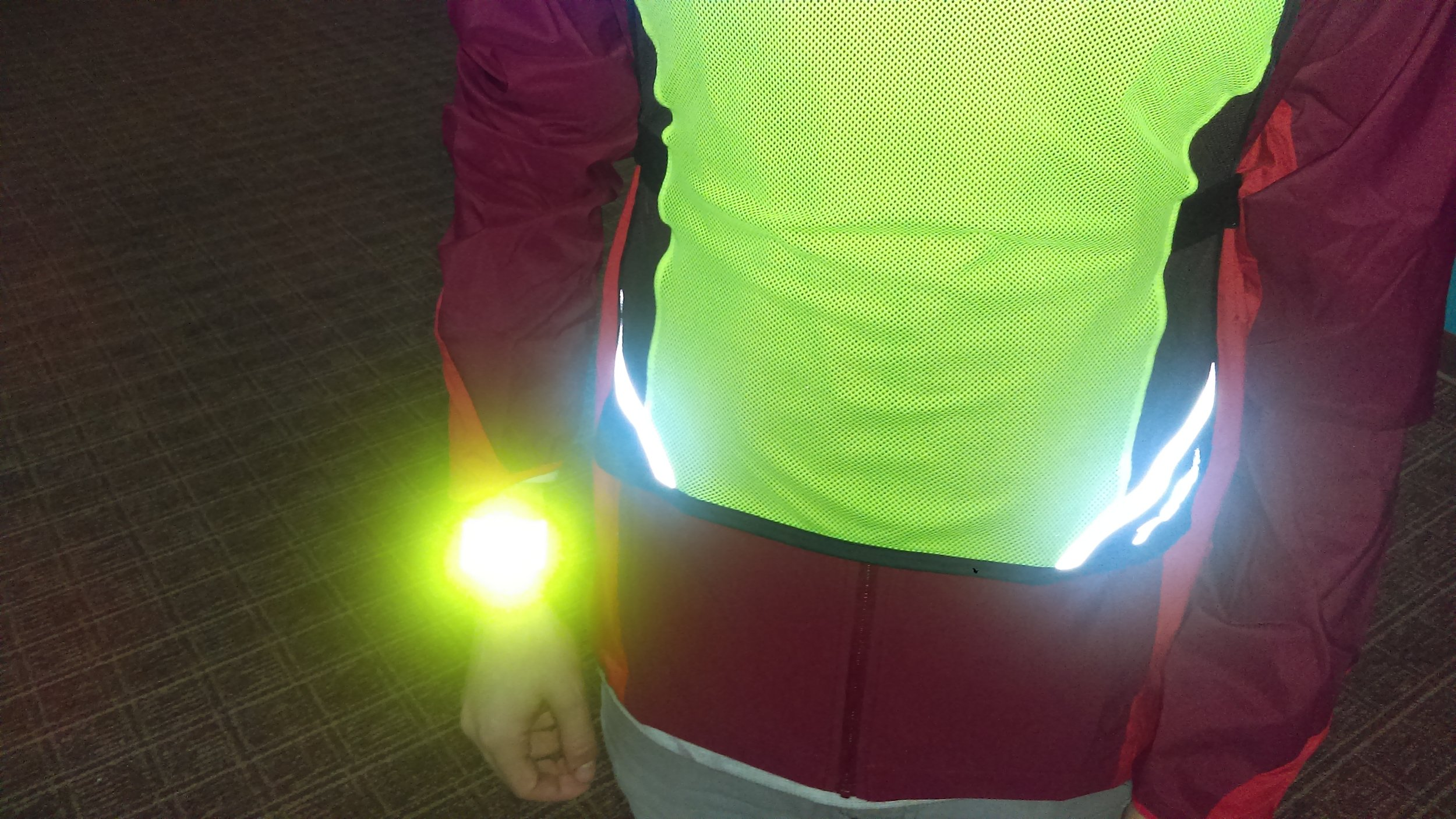 Here, Jason models our  reflective slap-on bracelet   which is both easy to strap onto a wrist (or ankle) and also very visible! Running with an arm bracelet provides short bursts of light that can break up a driver's vision and make it easier to be seen. The same thinking goes into blinking lights.