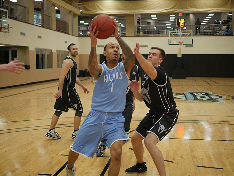 Steib drives to the basket as a member of the Polars in the UH Dream League