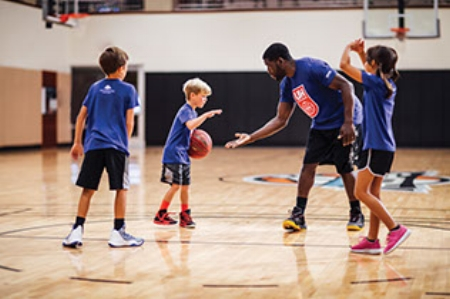 kids-basketball-class-high-five