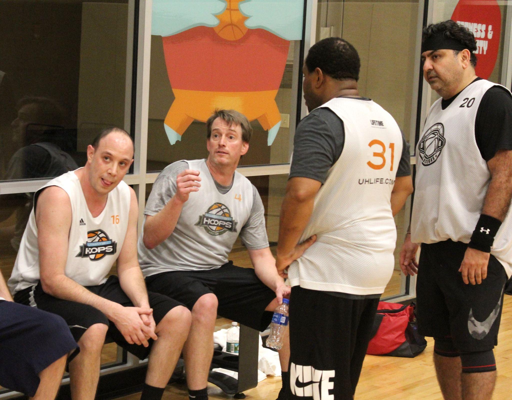 Harris leading his team huddle.