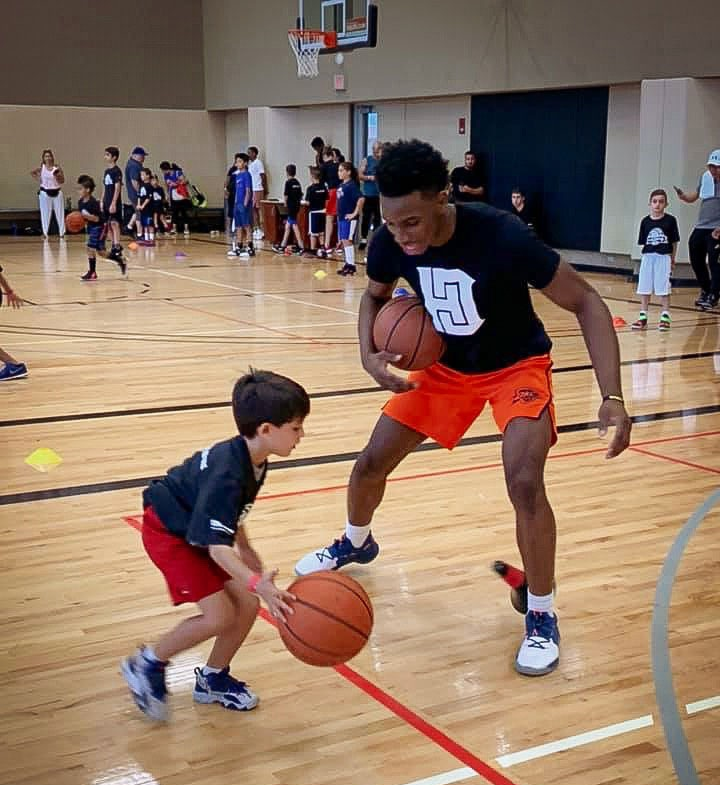 Diallo partnered with a young camper at Life Time- Syosset on Saturday.