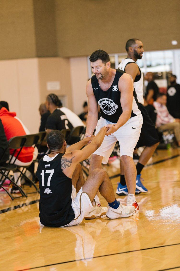 Farber (38) helping up a teammate