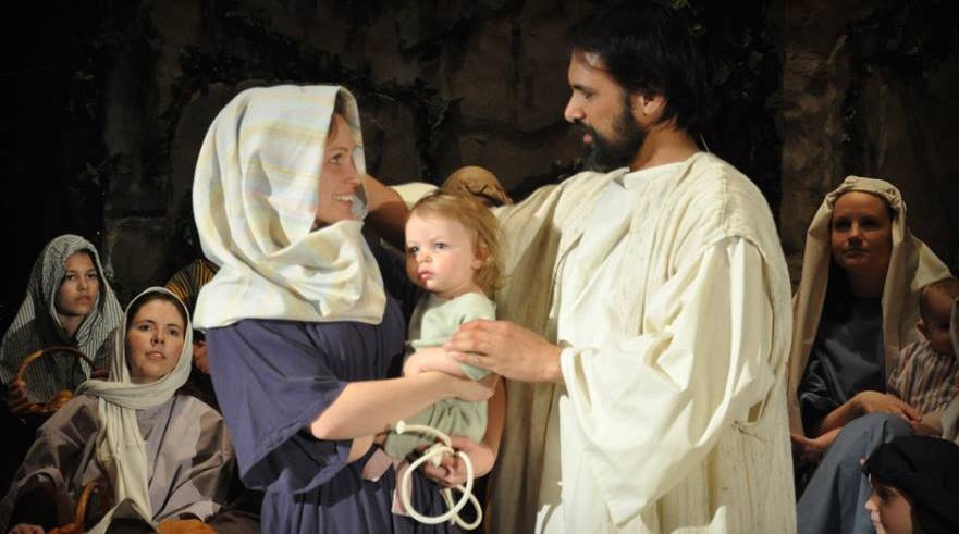 Kali & Faith Cantrell blessed by Jason Moore, portraying Jesus, in This Day of Resurrection 2015.