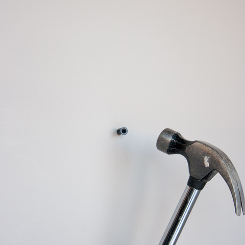 2) Insert the plastic anchor into the hole. Hammer in until the outer ridge of the anchor is flush against the wall    3) Insert the screw and slowly screw it into the anchor    - Screw perfectly perpendicular to the wall    (You may do this by holding the screw straight and steady with your other hand)