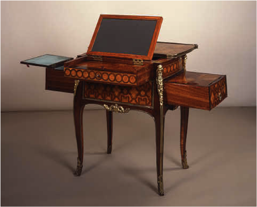 Toilette à Transformations (Dressing and Writing Table), c. 1764/1775  Jean-François Leleu (cabinetmaker)  Material: veneered on oak with tulip-wood, kingwood, pear-wood, purple-wood, sycamore, holly, boxwood, and ebony, some of the woods being originally stained green and other colors; drawers partially of mahogany; sparsely mounted with gilded bronze  Dimensions: 70.5 x 55.8 x 39.3 cm (27 3/4 x 21 15/16 x 15 1/2 in.)  Widener Collection 1942.9.422