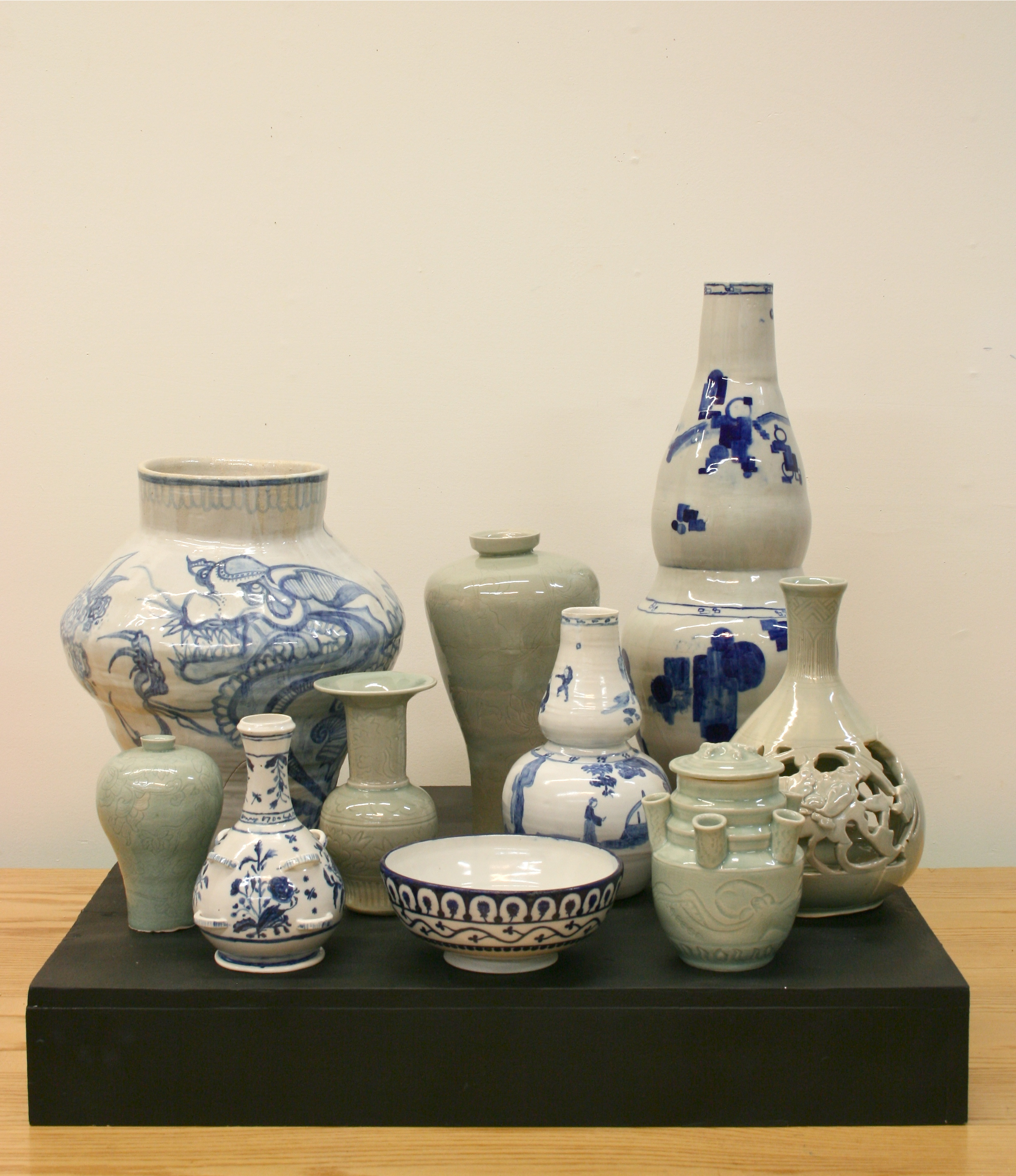 A selection of celadon and cobalt pots created from objects in the collection of the Asian Art Museum in San Francisco the Victoria and Albert in London. These students were asked to adjust the scale and decorative scheme as they created their own versions of the originals.
