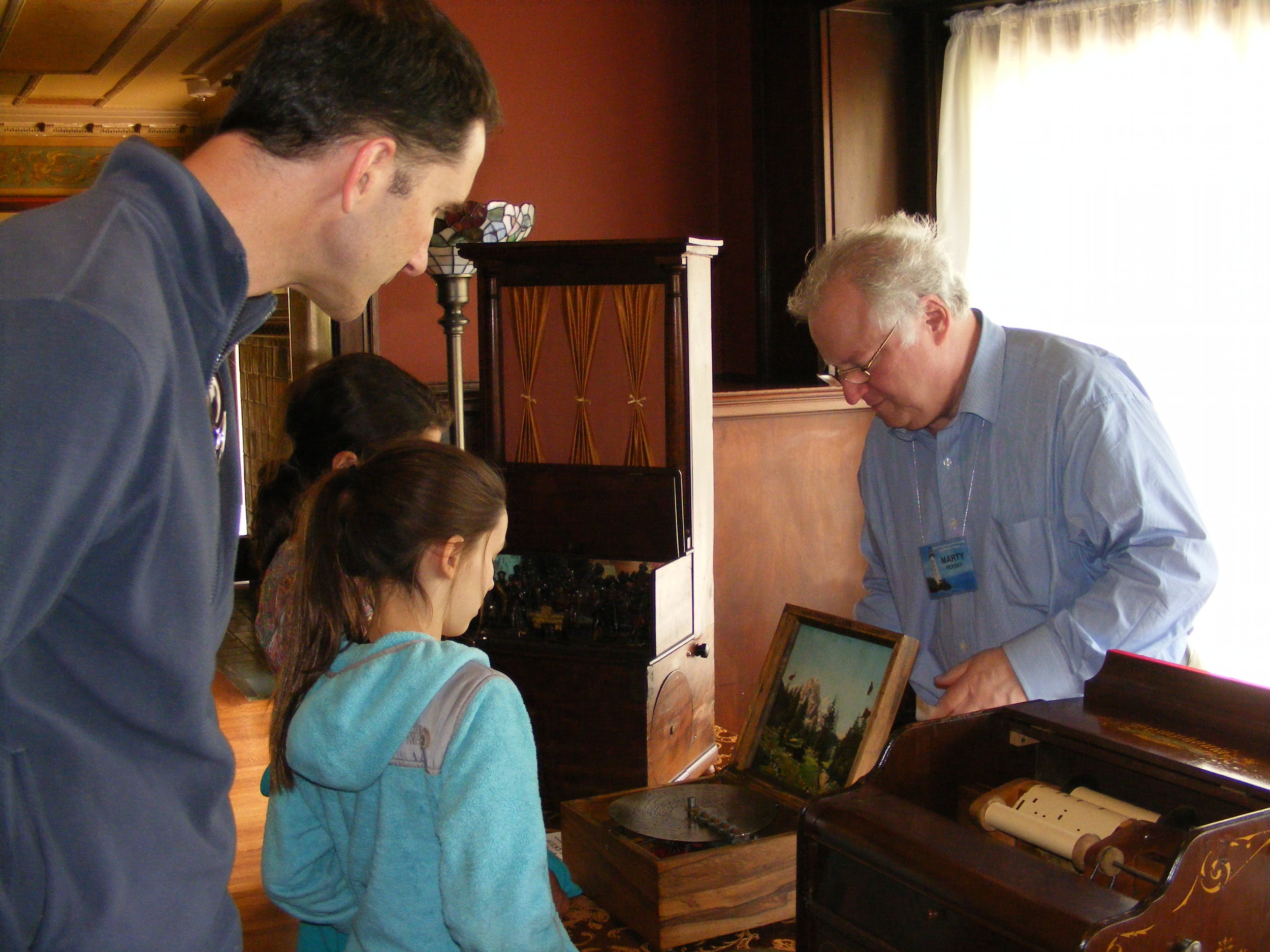 Demonstrating instruments for the public at the former residence of Herbert Mills of the Mills Novelty Company.