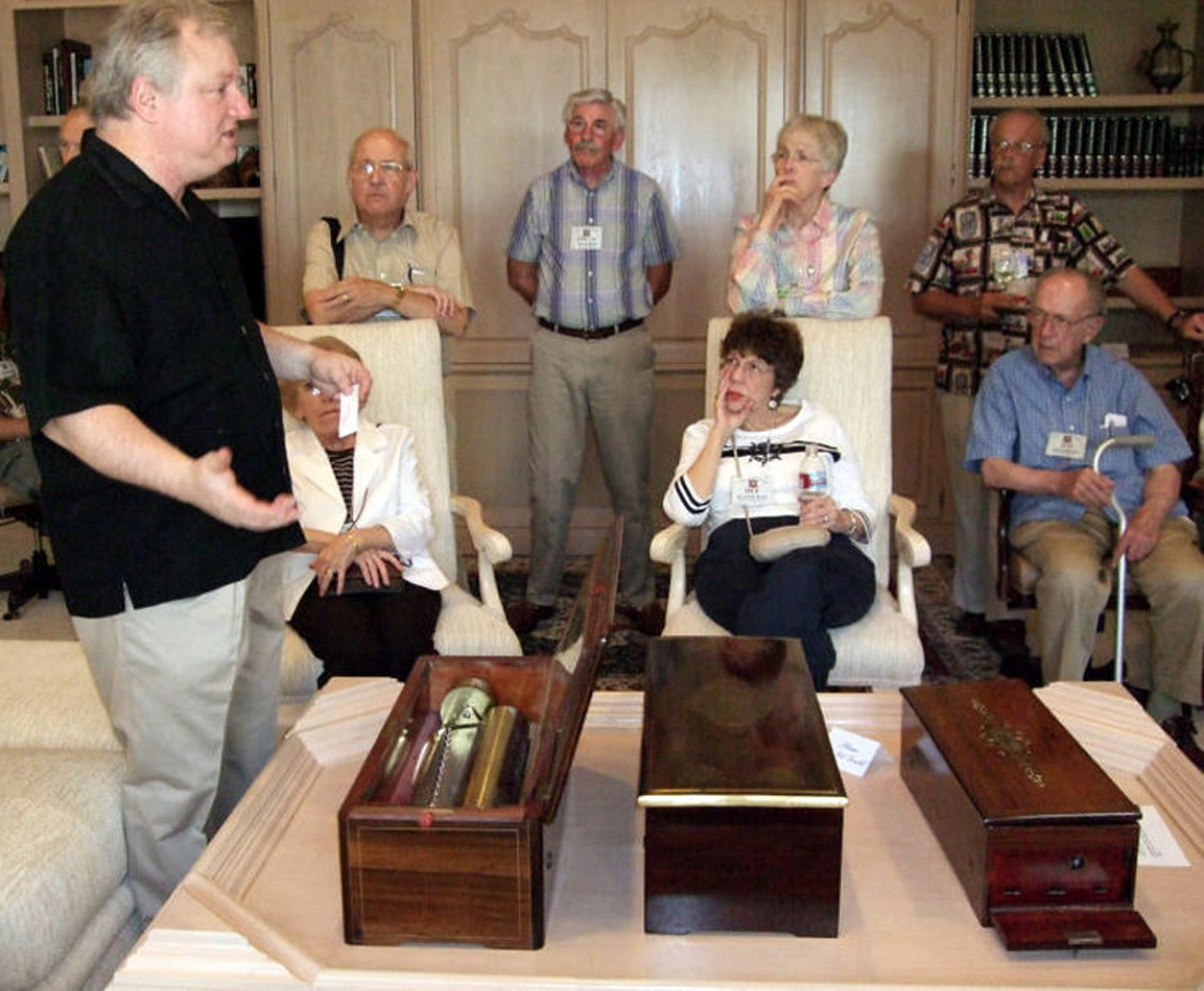 Explaining attributes of several highest quality mid-nineteenth century cylinder music boxes to collectors..