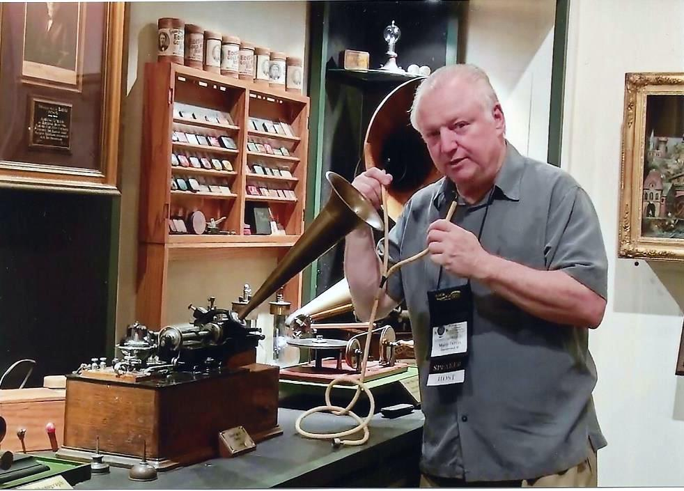 Demonstrating an early Edison Class M phonograph.
