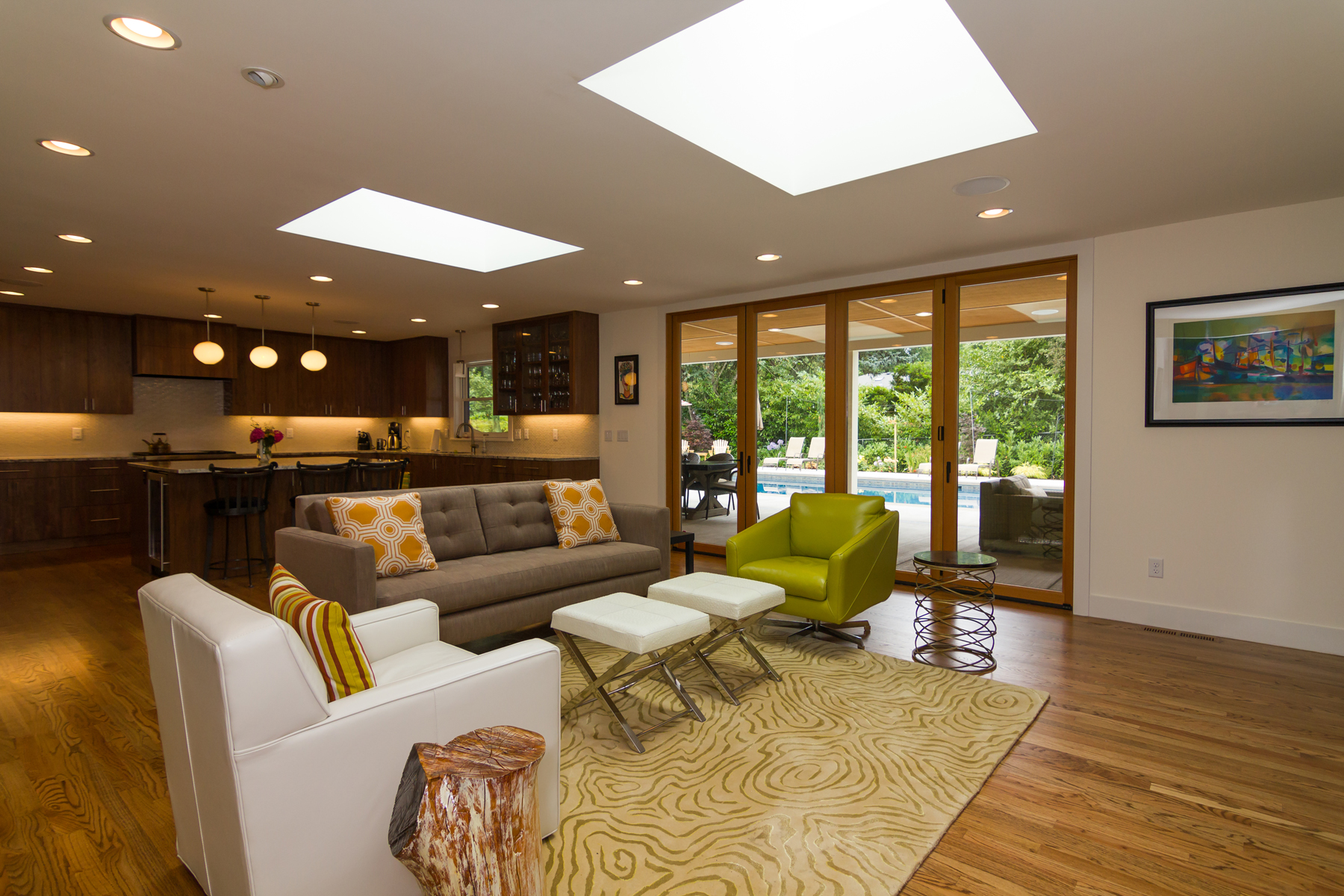 Open floor plan living space. La Cantina Doors allow seamless interior/exterior transition. Two skylights open up the space vertically and provide lots of natural light, even on overcast days.
