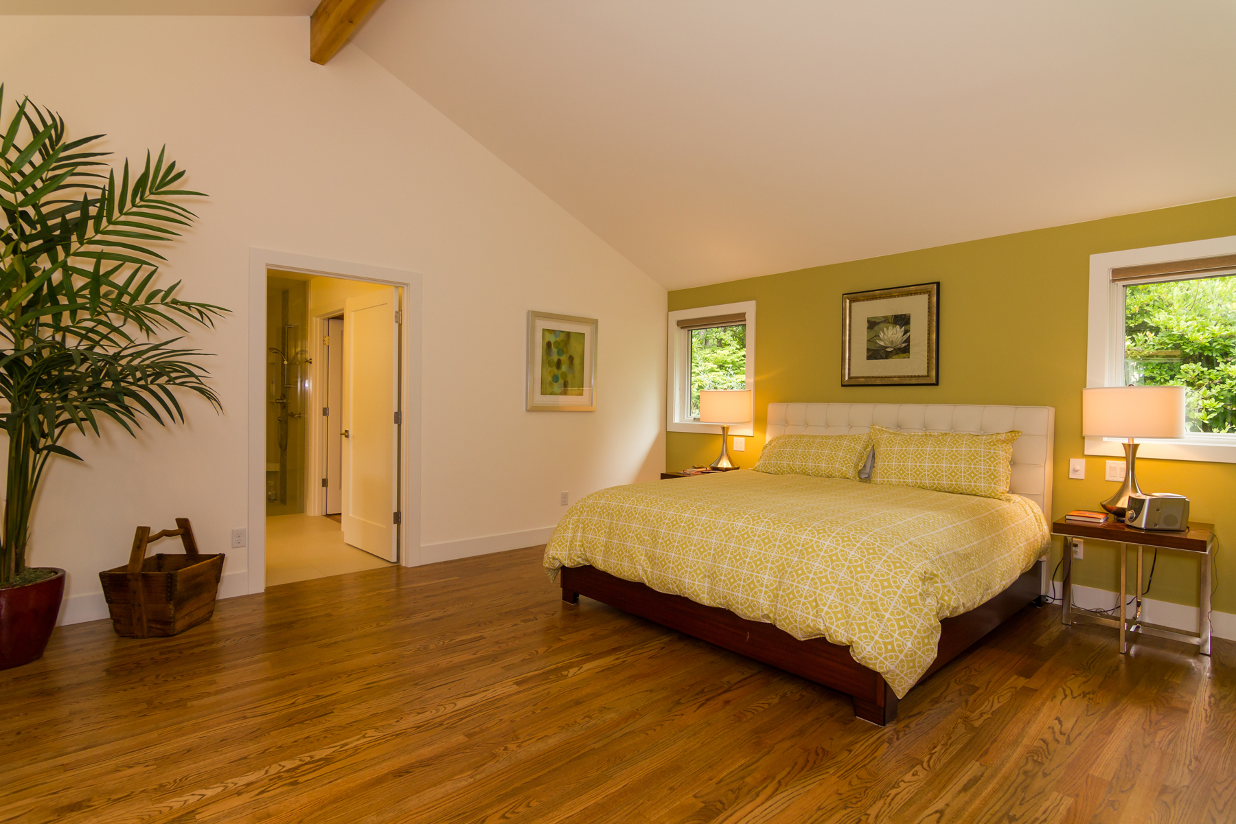Master bedroom addition. High ceilings follow roofline up to exposed beam.