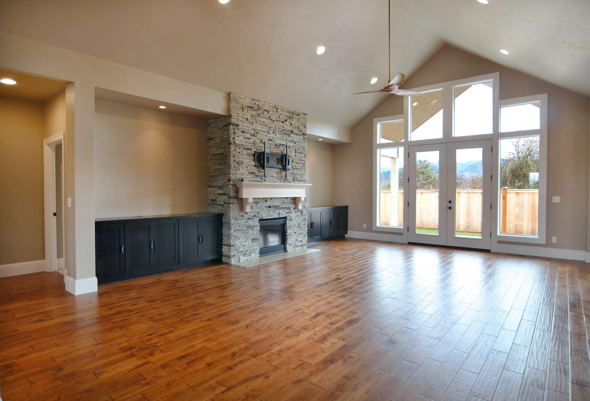 Great room with vaulted ceiling - *This these photos are similar to our new home that is under construction on Lot 33