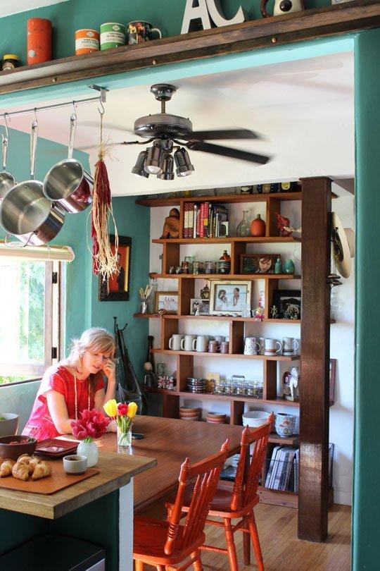 Asymmetrical shelves in a colorful kitchen