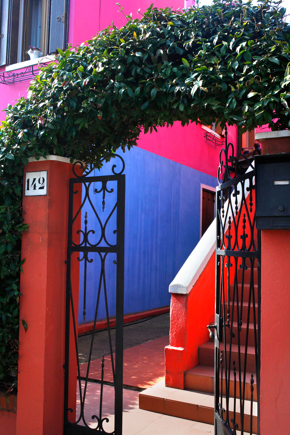 Gated entrance in Burano, Italy | Freckle & Fair