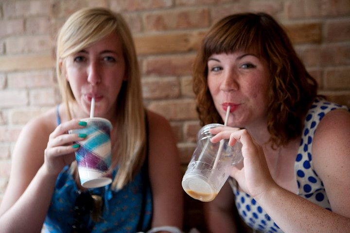 Katie and Theresa drinking iced coffee in Brooklyn after junior year of college
