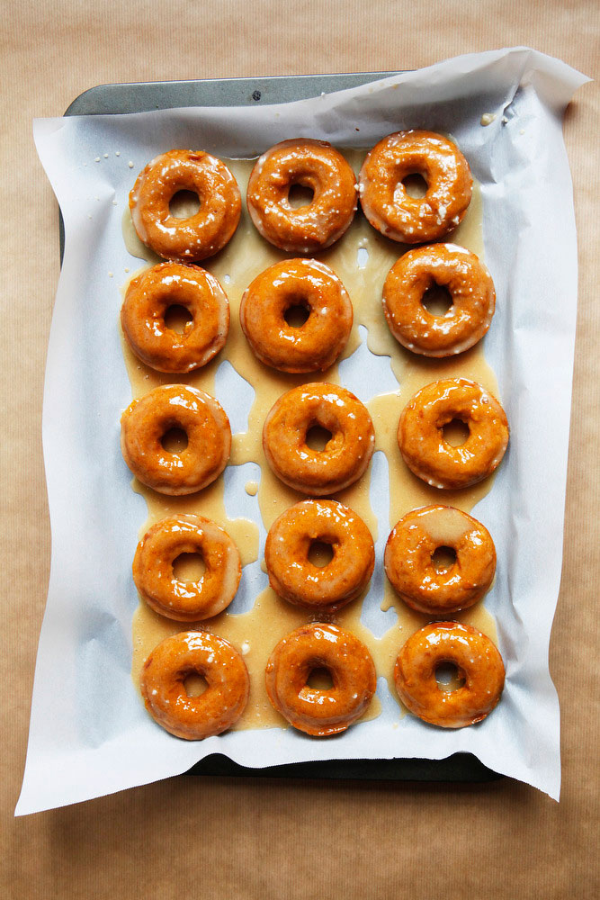Pumpkin donut tower cake with maple bourbon and salted caramel glazes | Freckle & Fair