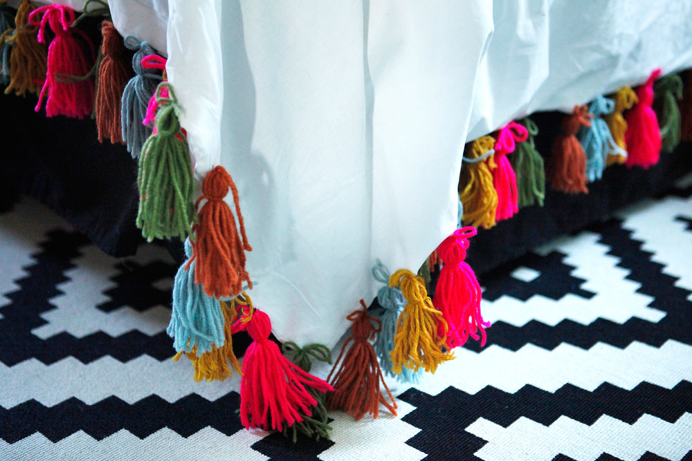 DIY yarn tassel duvet blanket | www.freckleandfair.com