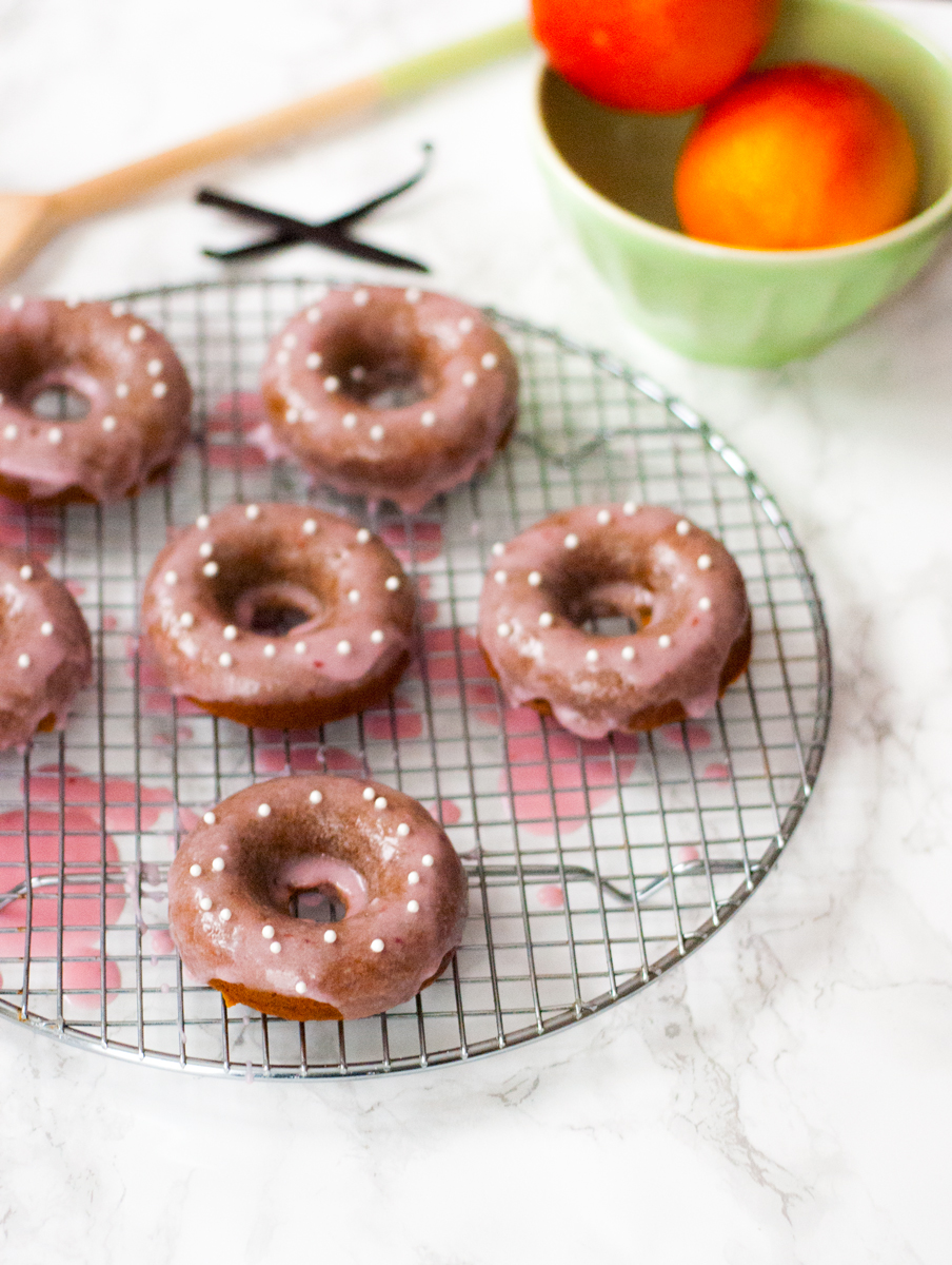 Blood orange glazed vanilla bean baked donuts | freckleandfair.com