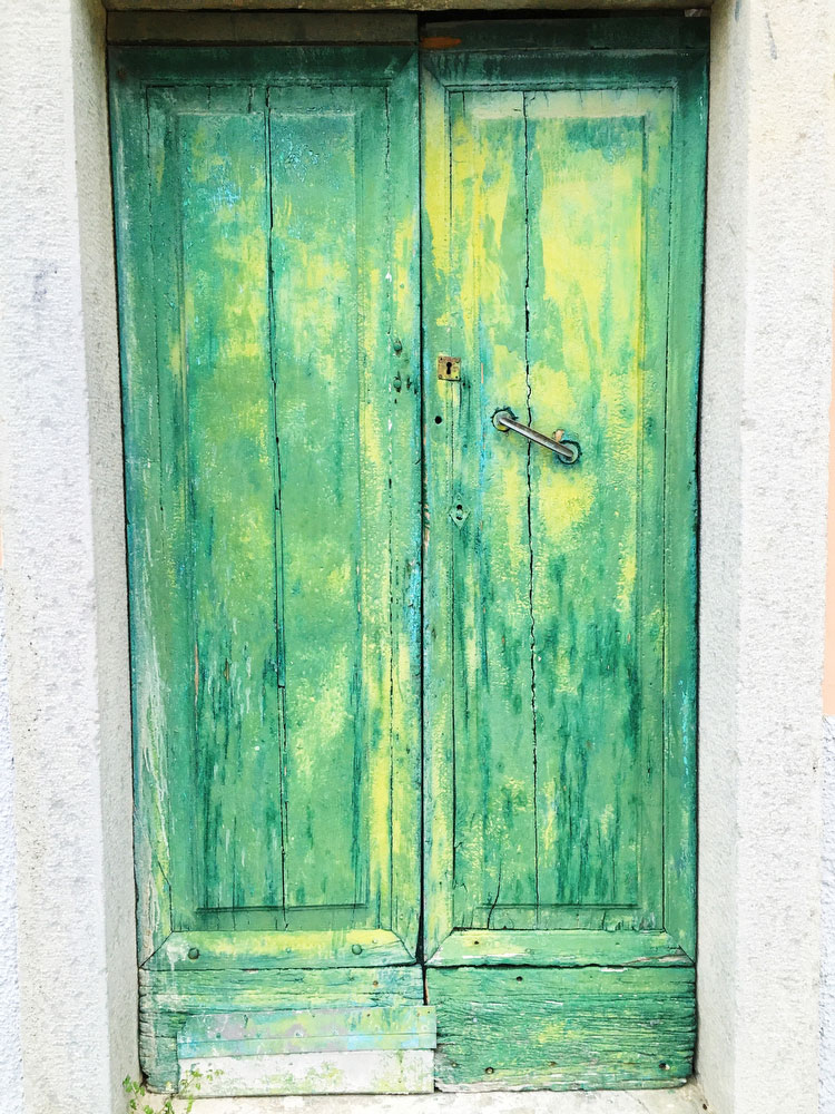 Old doorway in Cinque Terre, Italy | freckleandfair.com