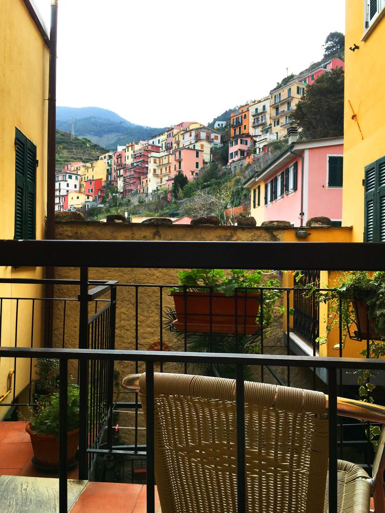 Rainbow road trip round-up: Our favorite colorful cities — Manarola, Cinque Terre, Italy   freckleandfair.com