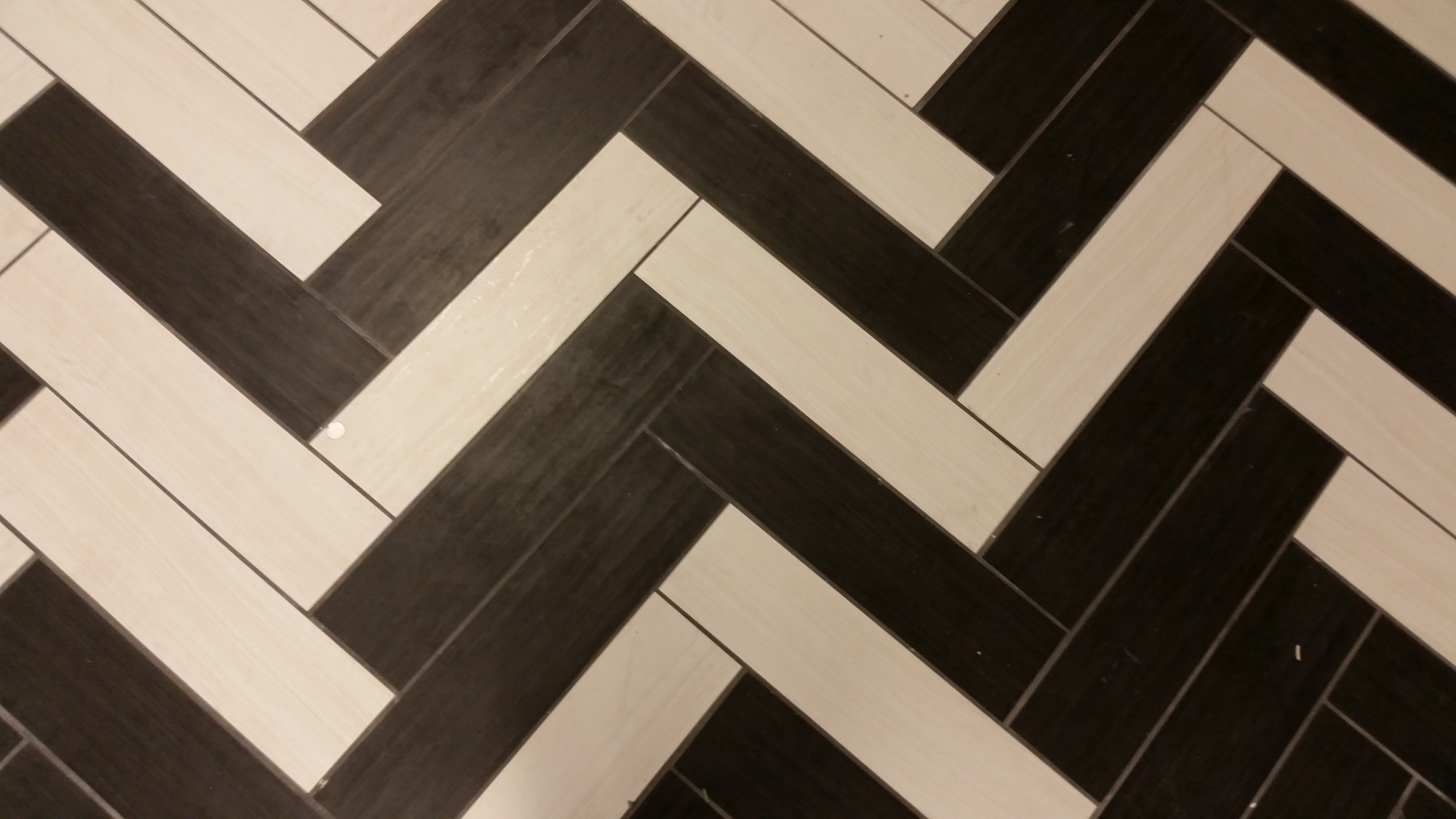 The white tile fades to dark in a graphic pattern.