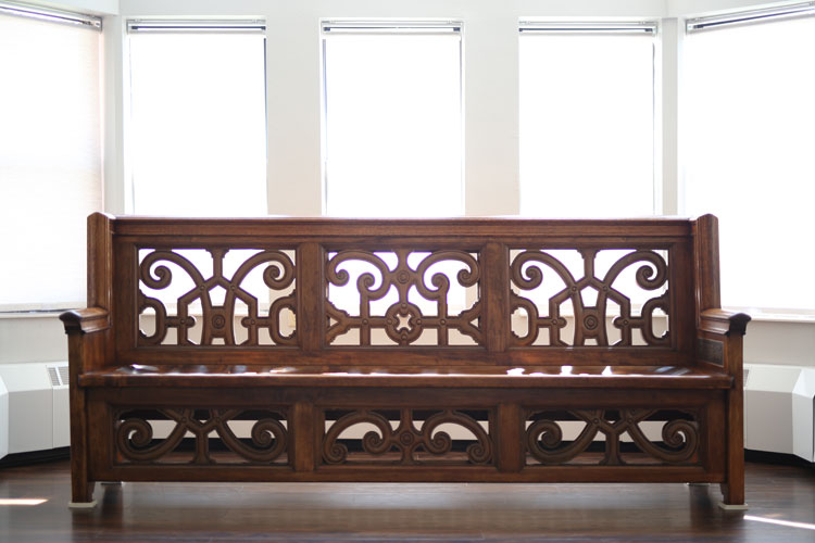 Custom bench crafted from the original Emerson Hall staircase.