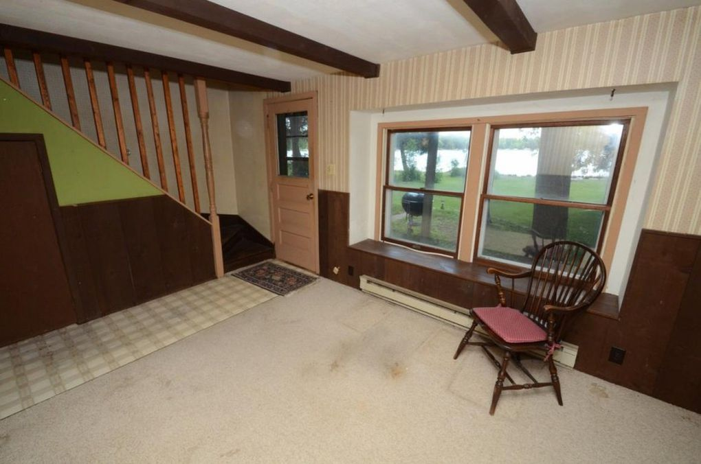 Sitting room off of family room with access to upstairs bedroom and the backyard.