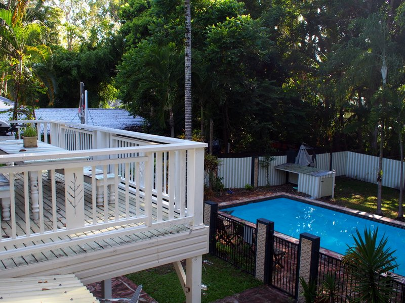 The pool and upstairs balcony