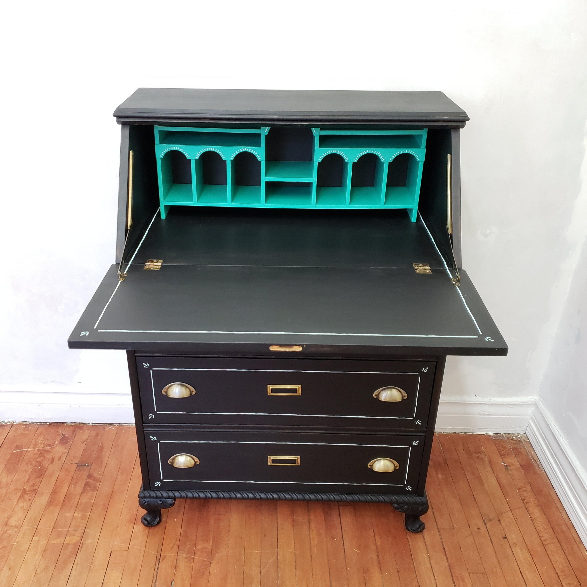 Gorgeous transformation with mineral paint and new hardware.