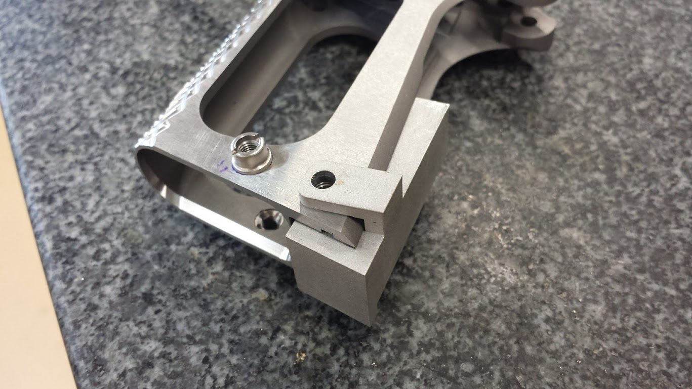 8. Frame modified for GEN 2 Chen Magwell with Installation jig inserted. Installation jig facilitates the relocation of the Mainspring Housing Pin Hole.
