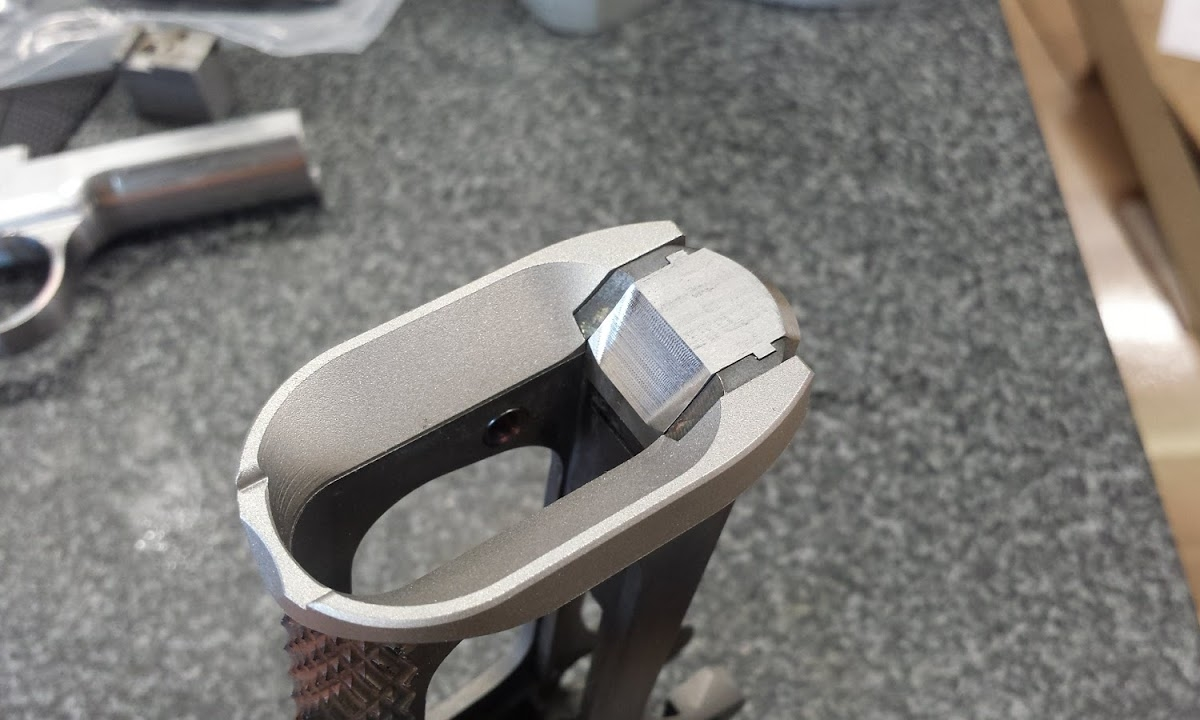 """4.  Frame modified for GEN 1 Chen Magwell. Magwell funnel and a modified Mainspring Housing is inserted. A ramp has been cut into the Mainspring Housing to make blending the entire funnel aperture easier for the gunsmith. These two pieces form the GEN 1 Magwell aka """"Chen Magwell Suite"""""""