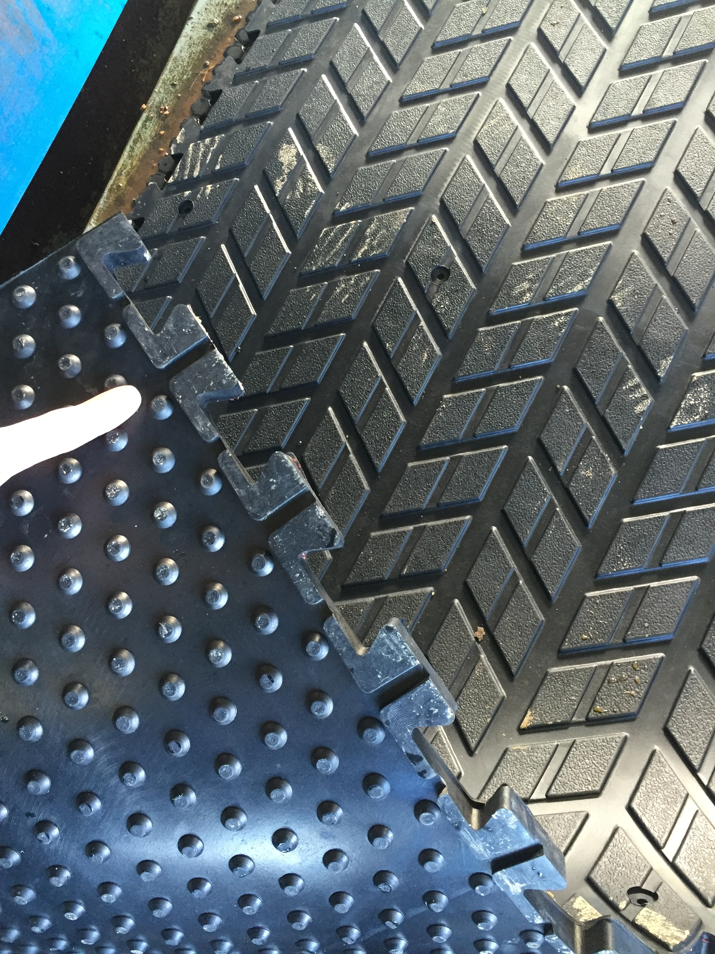 Stud underside for give and softness underfoot and interlocking edge and drainage points