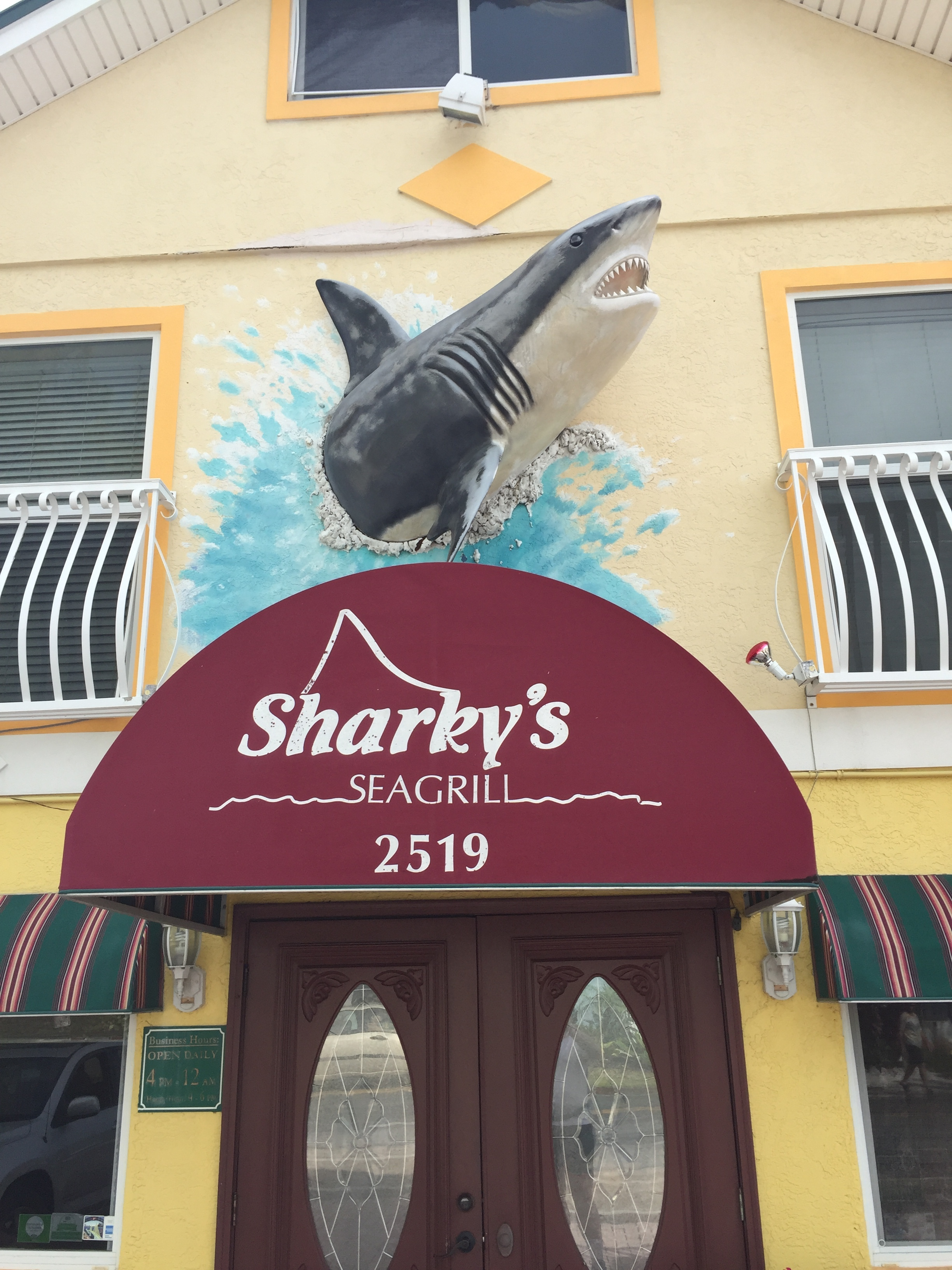 Yup.  Sharky's Restaurant.  Complete with giant shark statue bursting out of the wall of the restaurant.